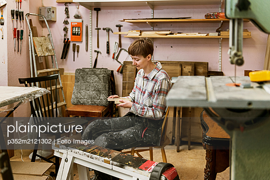 Carpenter in workshop - p352m2121302 by Folio Images