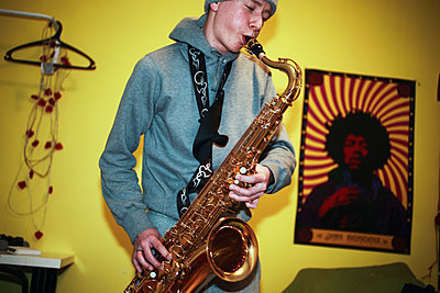 Teenage Boy Playing The Saxophone    - p847m1102349 by Mikael Andersson