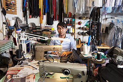 Man at sewing station - p352m1536398 by Ulf Isacson