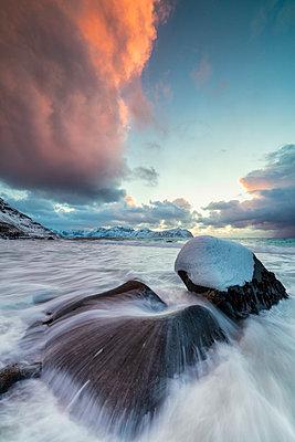Ice on rocks in the rough sea, Vikten, Flakstad municipality, Lofoten Islands, Norway - p651m2033192 by Roberto Moiola