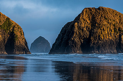 Haystack Rock and other sea stacks seen on Crescent Beach; Cannon Beach, Oregon, United States of America - p442m2039286 by Robert L. Potts