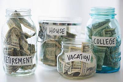 Close up of savings jars with money - p555m1411442 by JGI/Jamie Grill