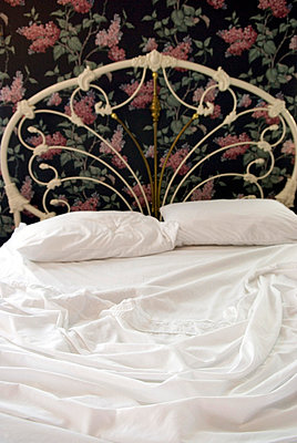 Unmade Bed with White Sheets - p5690156 by Jeff Spielman