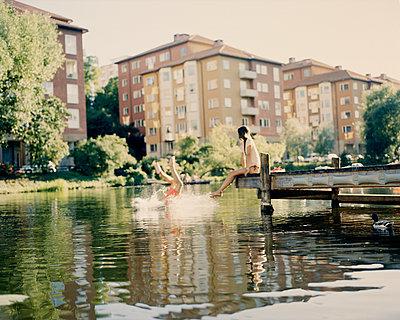 Couple having a swim - p312m1024766f by Nicho Sodling