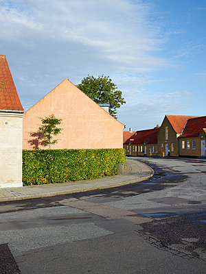 Houses by road in town - p312m1472838 by Jan Tove