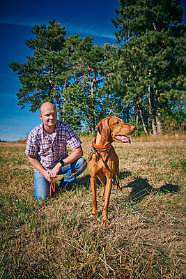Man and dog - p227m2008240 by Uwe Nölke