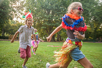 Children in costume running in park - p429m2019430 by Seb Oliver