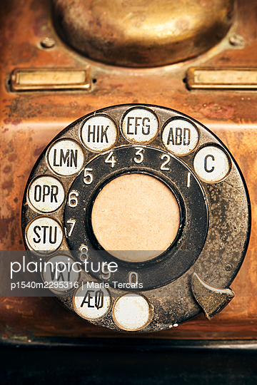 Rotary dial of an old telephone - p1540m2295316 by Marie Tercafs
