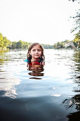 Girl bathing in lake - p1019m2122603 by Stephen Carroll