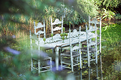 Ornate dining table floating in pond - p675m922834 by Odilon Dimier