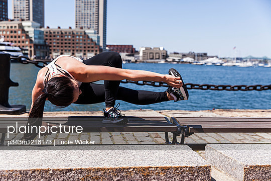 Woman Doing Exercise On The Bench Near River