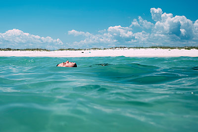 Man Floating in Gulf of Mexico - p1262m1584314 by Maryanne Gobble