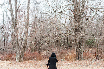 Girl with hood in forest - p956m892208 by Anna Quinn