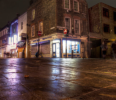 Brick Lane corner shop at night - p1072m829302 by Neville Mountford-Hoare