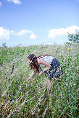 Young woman on a meadow - p502m924234 by Tomas Adel