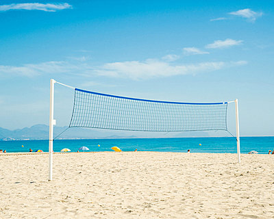 Volleyball net on beach, Benidorm, Costa Blanca, Spain - p9242067f by Image Source