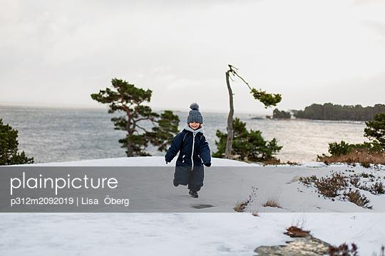 Girl on winter coast - p312m2092019 by Lisa  Öberg