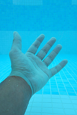 Human hand underwater - p1189m1219032 by Adnan Arnaout