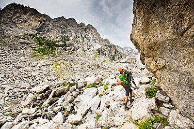 A backpacker going through rocky terrain. - p343m1184711 by Rob Hammer