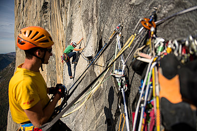 Two men free climbing a big wall route on El Capitan in Yosemite National Prk in the Sierra Nevada Mountains, California. - p343m1184347 by Paolo Sartori