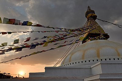 Prayer flags hanging from monument - p429m1148970 by Ben Pipe Photography