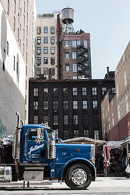Blue Truck in a city - p1291m1548117 by Marcus Bastel