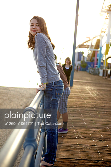Girl on pier - p1260m1064721 by Ted Catanzaro