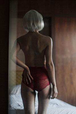 Woman in bedroom - p1098m923980 by Studio MPM