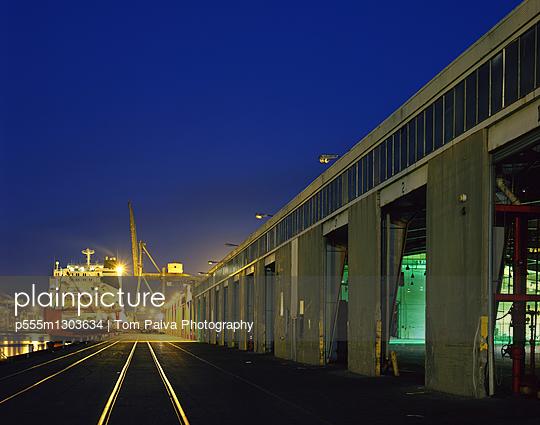 Railroad tracks at harbor at night - p555m1303634 by Tom Paiva Photography
