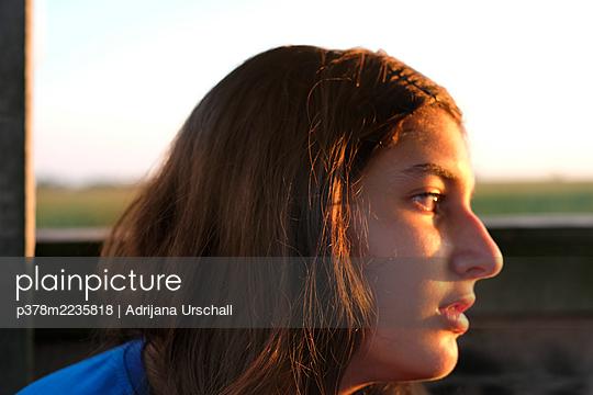 Sunlit young girl - p378m2235818 by Adrijana Urschall