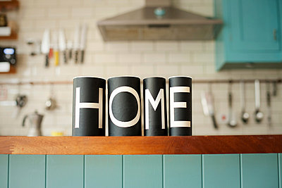 Word 'Home' on kitchen counter - p924m806985f by Ian Nolan