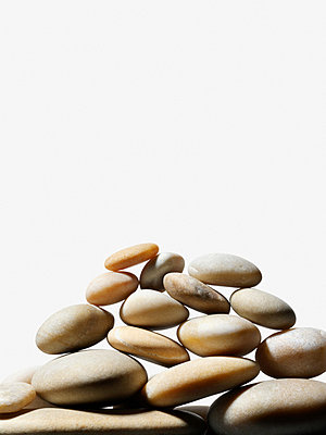 Stack of pebbles - p9247602f by Image Source