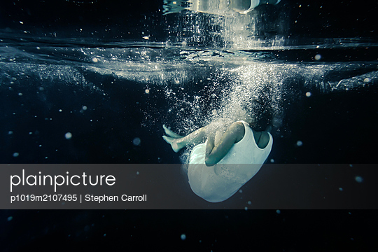 Woman Falling Under Water - p1019m2107495 by Stephen Carroll