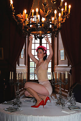 Woman in vintage lingerie on a table in a castle - p1521m2214961 by Charlotte Zobel