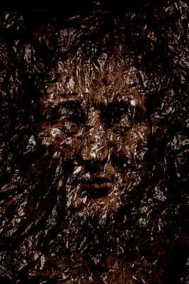 Face behing plastic  - p1028m2187252 by Jean Marmeisse