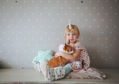 Little girl and dog - p1414m2044856 by Dasha Pears