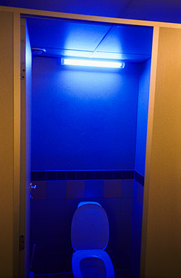 Blue neon light in toilet - p1418m1571787 by Jan Håkan Dahlström
