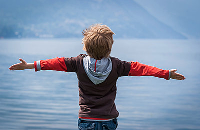 Italy, Lombardy, Province Como, Menaggio, Young boy at Lake Como - p300m941029f by Andreas Pacek
