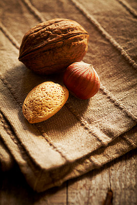 Walnuts on a wooden table - p968m658860 by Roberto Pastrovicchio