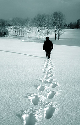 Man walking away - p4760346 by Ilona Wellmann