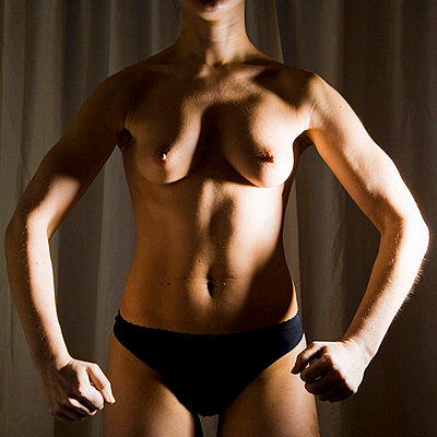Naked strong woman - p4130485 by Tuomas Marttila