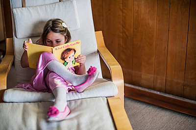 Young Girl Reading Book - p694m1014832 by Kristianne Riddle