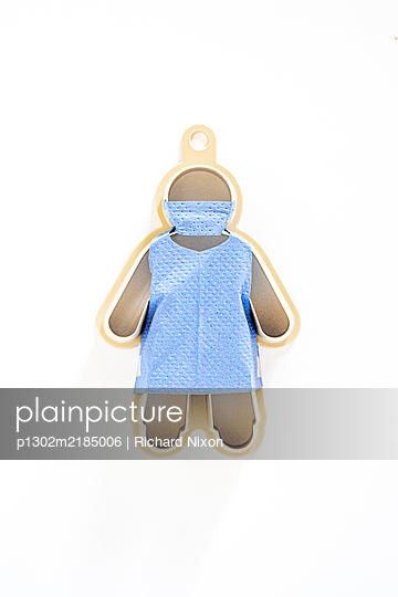 Plastic cookie cutter wearing a surgical face mask and apron - p1302m2185006 by Richard Nixon