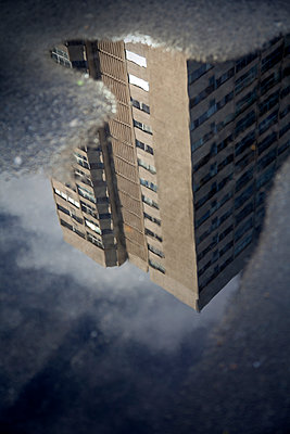 Building Reflected in Puddle - p1248m2053883 by miguel sobreira