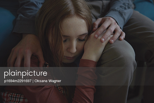 Young couple in love sitting close to each other and holding hands - p1694m2291697 by Oksana Wagner