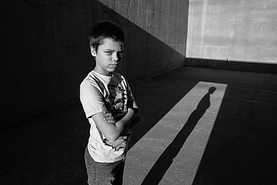 Confident Boy with Arms Crossed - p1262m1064007 by Maryanne Gobble