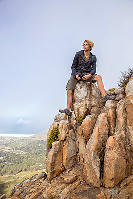Young man on a hiking trip high in the mountains - p1355m1574518 by Tomasrodriguez