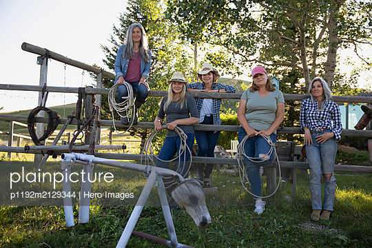 Portrait of women at roping class on ranch - p1192m2129344 by Hero Images