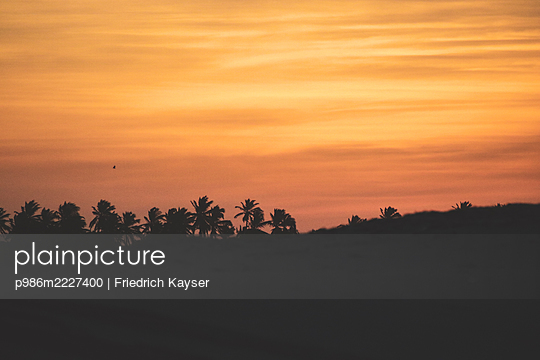Brazil, Sunset in Taiba - p986m2227400 by Friedrich Kayser