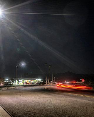 USA, California, Gas Station at Night - p1154m2229525 by Tom Hogan